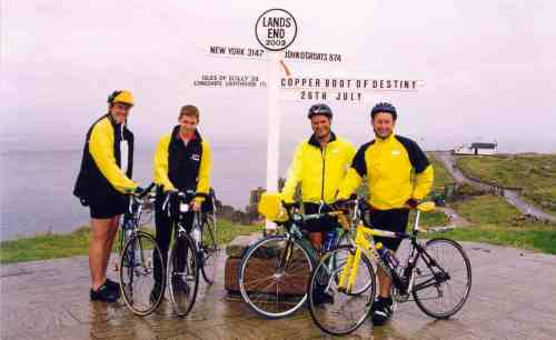 Posing at the Lands End signpost at the start of our Lands End to John O'Groats cycle