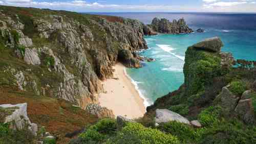 The stunning view across the bay to Logan Rock, Treen near Porthcurno in Cornwall